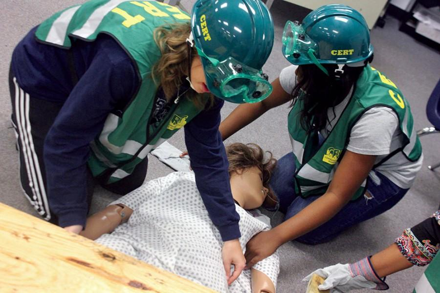 Juniors Sarah Faiq and Jayla Ford practice cribbing with their CERT incident commander. They successfully pull the mannequin from underneath the debris.