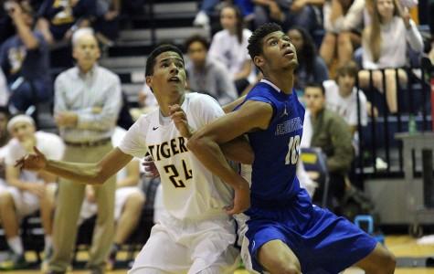 Varsity Basketball Teams Make Way through District Play