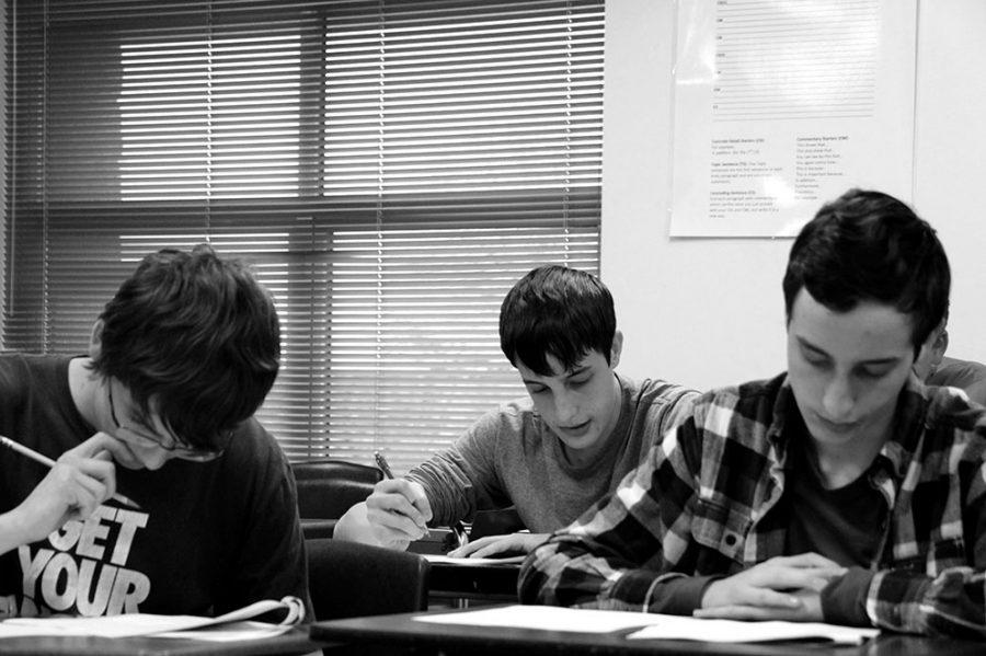 Juniors Nathan Sippel, Ethan Santoni-Colvin and Morgan Santoni-Colvin take mock UIL tests.