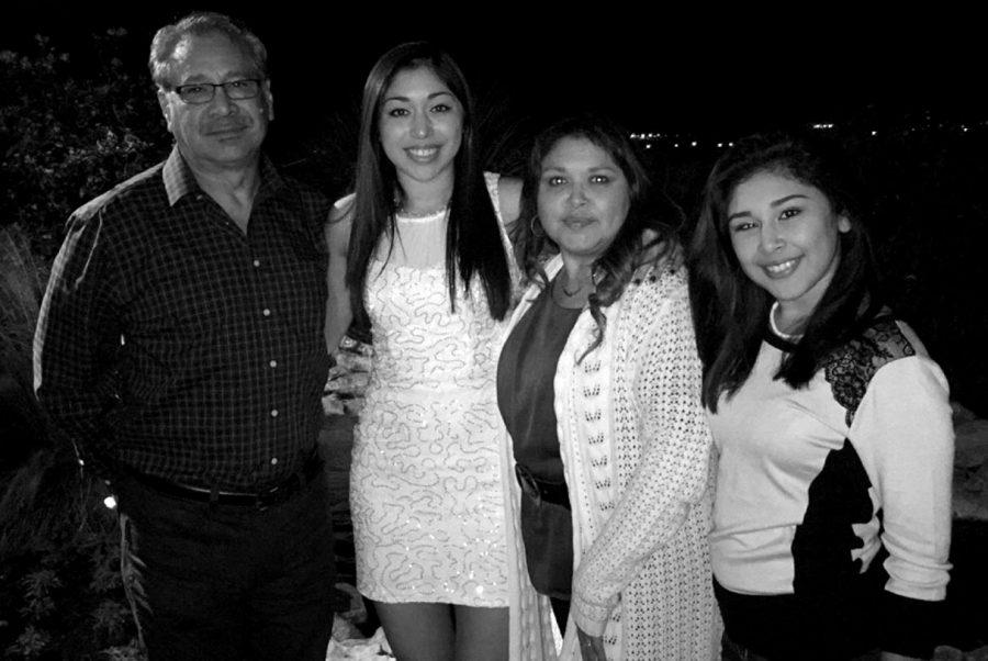 Freshman Emory Alvarado and her family happily attend Alvarado's volleyball banquet.