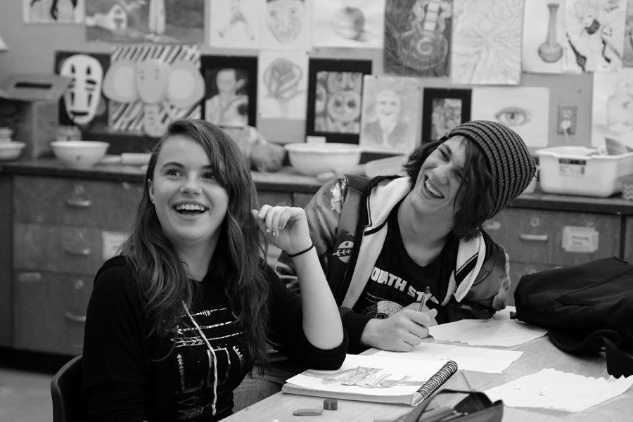 1. Team drawing: Sophomore Sama'ra Crawford and senior Kristopher Kellerman laugh during a discussion.