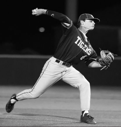Junior pitcher Jack Driskell prepares to release his pitch, looking to strike out his opponent.