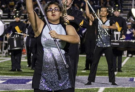 "Performing their show, ""ORGANic,"" sophomore Maribel Ojeda concentrates on her flag movements, something Dunham will be practicing for next year."